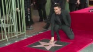 The lead singer of Maroon 5 Adam Levine who is also a judge on hit talent show 'The Voice appears at the ceremony for the unveiling of his star on...