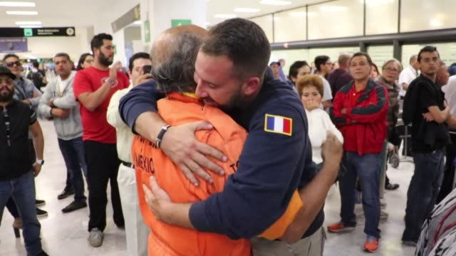 The leader of the Mexican rescue mission Topos Aztecas Hector Mendez warmly greets Bastien Bizieux the founder of the French international fire...