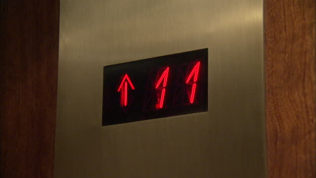 The LED display in an elevator counts up from floor 1 to floor 65. Available in HD