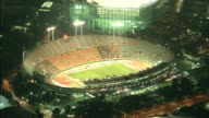 The lights of the National Stadium in Tokyo stand out among the city lights at night / National Stadium in Tokyo is the symbolic venue of the 1964...
