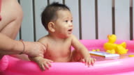 The little baby bathes in inflatable pool