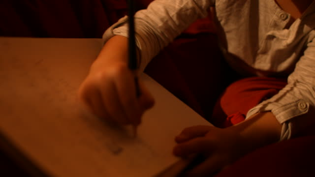 The little boy writes a letter to Santa