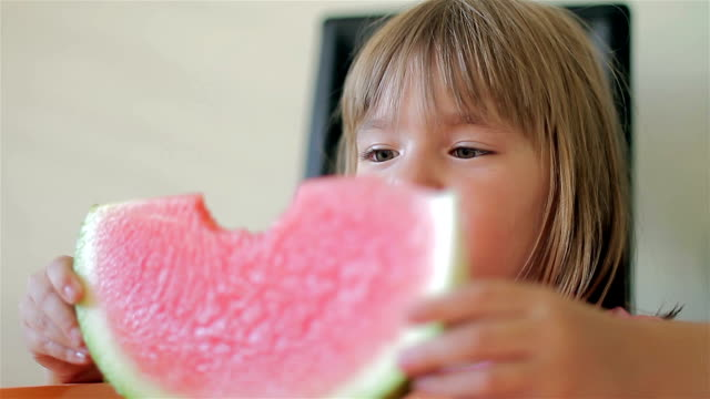 The little girl with watermelon