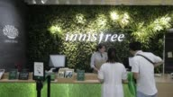 The logo of Innisfree an Amorepacific Corp cosmetic brand is displayed at a brand store in the Ngee Ann City shopping and commercial center in...