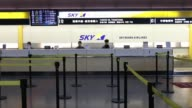 The logo of Skymark Airlines Inc is displayed at the company's counter at Haneda Airport in Tokyo Japan on Thursday Jan 29 The logo of Skymark...