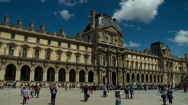 T/L WS The Louvre in Paris, France with clouds
