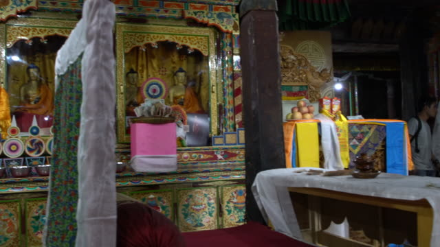 The main praying room decorated with murals and paintings inside Thiksay Monastery, Ladakh, India