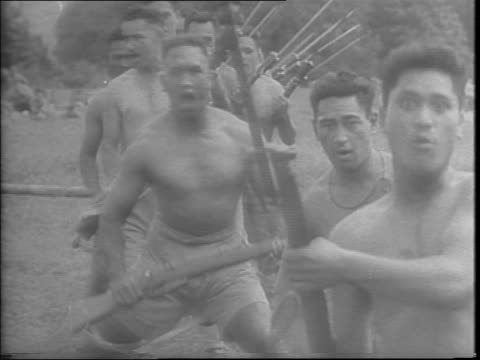 The Maoris on a training course drilling with bayonets running with guns