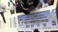 The mascot for the Africa Cup of Nations leads celebrations as AFCON tickets go on sale in Gabon