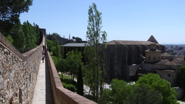 The medieval walls surrounding the city of Girona in Spain