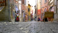 The narrow cobbled shopping streets.