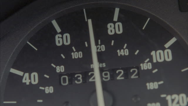 The needle on a speedometer fluctuates from sixty to one hundred miles per hour.