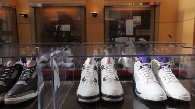 The Nike Inc headquarters campus stands in Beaverton Oregon US Wide shots of campus buildings interiors shots featuring various products on display...