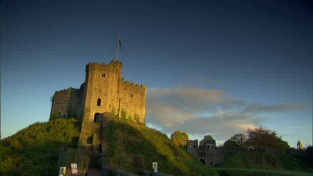 The Norman Keep on top of hill some clouds in blue sky BG Medieval Victorian United Kingdom UK