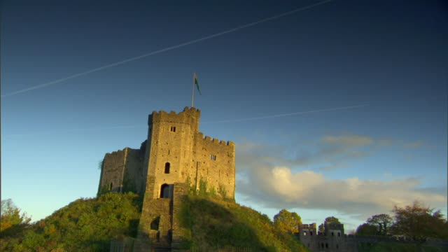 The Norman Keep on top of hill some streaks clouds in blue sky BG Medieval Victorian United Kingdom UK