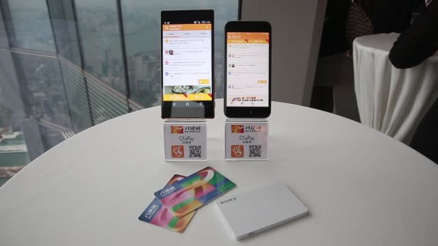 The O ePay mobile payment service app developed by Octopus Cards Ltd a subsidiary of MTR Corp is displayed on an Apple Inc iPhone next to an octopus...