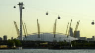 The O2 and passing cable cars crossing the Thames