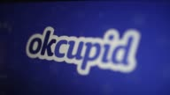 The OkCupid application is displayed in the Apple Inc App Store in Washington DC US on Monday Feb 6 2017 Shots CU panning and tilting shots on a...