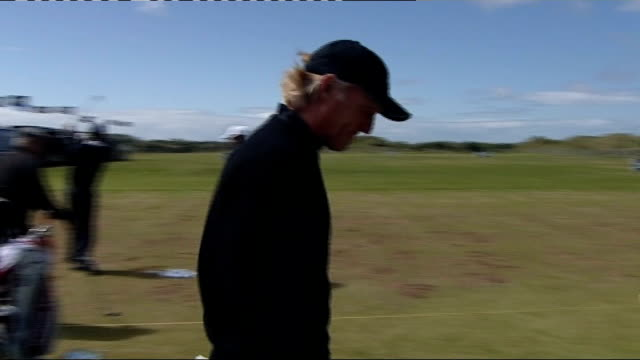 Players practising Players practicing on driving range / Greg Norman arriving at driving range / Harrington away / unnamed man interview SOT / The...