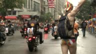 The parade kicks off with a procession of bikers on 5th Avenue / Crowds wave the rainbow flag in celebration
