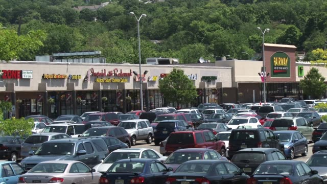 WS of the parking lot and stores of the West Fall Plaza Shopping Center in Woodland Park New Jersey / Stores include Fairway Markets Subway Joyce...
