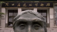 The Peking Man statue in Zhoukoudian, China. Available in HD.