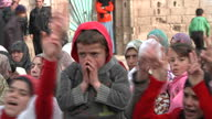 The people of Homs are under siege from Assad's forces Shows exterior shots children clapping singing at rally in Baba Amr on February 02 2012 in...