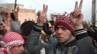 The people of Homs are under siege from Assad's forces Shows exterior shots people in Baba Amr at rally showing their support for the people being...