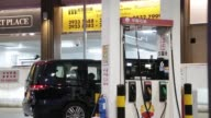 The PetroChina Co logo is displayed on a gas pump at one of the company's gas stations at night in Hong Kong China on Monday Aug 21 A pedestrian...