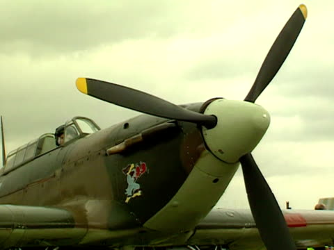 The pilot of a Hurricane aircraft starts the propeller 2000