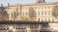 The Pont des Arts and the Louvre Museum across the river Seine, Paris, France.