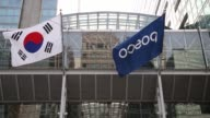 The Posco Center building stands in Seoul South Korea on Friday Jan 20 A South Korean national flag left and a Posco corporate flag fly outside the...