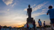The Posture Of Walking Buddhist Statue In Twilight Silhouette