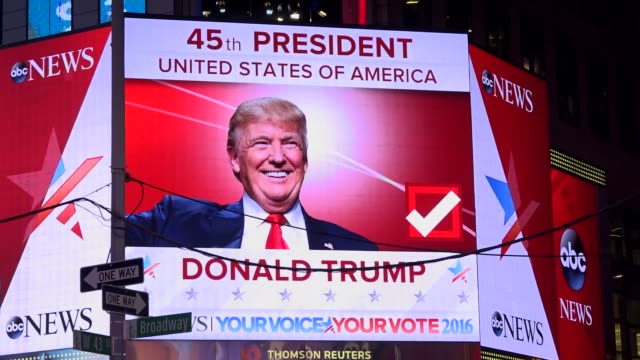 The presidential general election results between Donald Trump and Hillary Clinton was televised via giant electronic billboard screens in Times...
