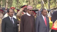 The presidents of Nigeria and Somalia join their Kenyan counterpart in a ceremony in memory of soldiers killed by Shebab Islamists