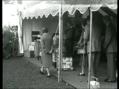 The Princess Anne collection 1 2241960 Princess Anne Prince Charles The Queen looking at goods for sale in tented village Princess Margaret fiance...