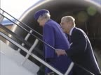 The Queen and Duke of Edinburgh walk up aircraft steps with huge aircraft engine in frame behind them as she undertakes one of her regular foreign...