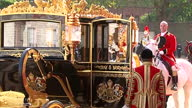 The Queen hosts the President of Singapore Shows exterior shots guests getting into back of Royal carriages on October 21 2014 in London England
