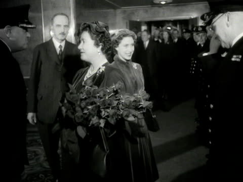 The Queen Mother and Princess Margaret arrive on the Queen Elizabeth ocean liner for their trip to America and greet some of the ships crew