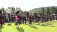 The Queen Prince Philip and Prince Charles attend the The Braemar Gathering in Scotland's Cairngorm Mountains