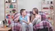 The relationships between teenagers resting in armchair indoors.