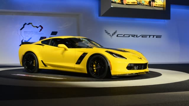 The reveal of a yellow 2015 Chevrolet Corvette at the North American International Auto Show in Detroit Michigan Various shots of the presentation of...