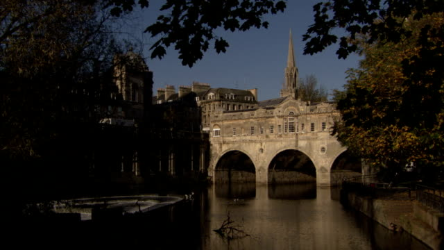 The River Avon flows under Pulteney Bridge in Bath, England. Available in HD.