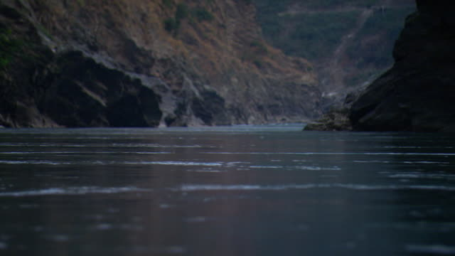 The River Ganges flows through a valley.