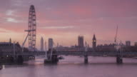 The River Thames, Palace of Westminster and London Eye at dawn.