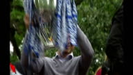 The role of fans in running British football clubs TX London EXT Roman Abramovich raising Barclays Premiership trophy aloft