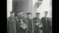 The Roosevelts stand outdoors in caps gowns and hoods with faculty of John Marshall Law School FDR is at right and Eleanor stands with college dean...