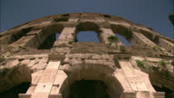 The ruins of the ancient Colosseum tower in Rome.