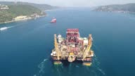 The Scarabeo 9 semisubmersible drilling rig passes through the Bosphorus Strait with tight security in Istanbul Turkey on September 18 2017 One lane...