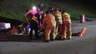The scene and victims being taken away on stretchers after a collision/rollover crash on the 805 in Chula Vista